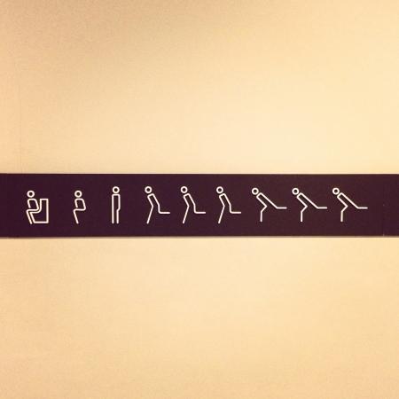 stop gesture: toilet sign