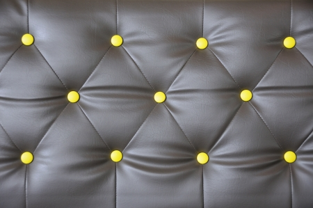 upholstered: leather brown yellow botton Stock Photo