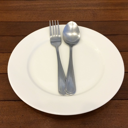 Fork, spoon and dish on the table Stock Photo
