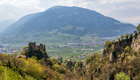 View on Castle Brunnenburg inside Valley and Alps of Meran Landscape. Tirol Village, Province Bolzano, South Tyrol, Italy.