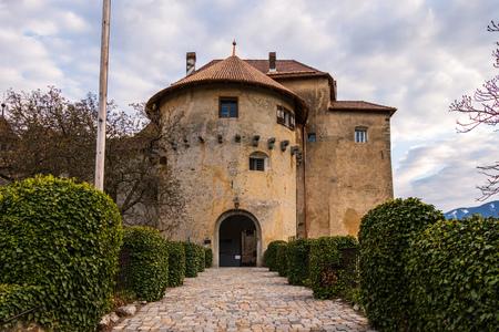 Entrance of Castle Schenna (Scena) near Meran. Schenna, Province Bolzano, South Tyrol, Italy.