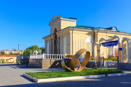 Historical Main Entrance to the large Cinema Theater, called Wostok with Monuments. The Entrance and Archway to the Kio park on the right. Located Downtown of Temirtau, Karaganda Region. Kazakhstan.