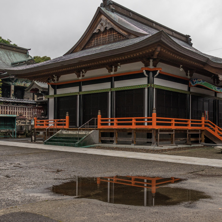View on japanese buddhistic Honmyoji Temple during a rainy day. Located in the capital of Prefecture Kumamoto, Japan, Asia.