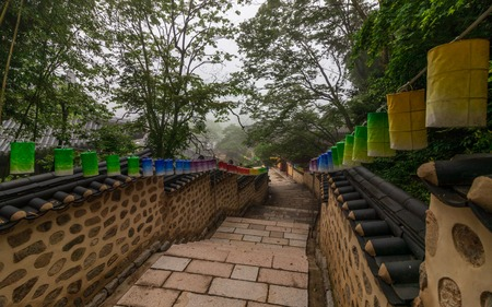 Pathway steps to Korean Buddhistic Temple Beomeosa with many lanterns to celebrate buddhas birthday on a foggy day. Located in Busan, South Korea, Asia 版權商用圖片