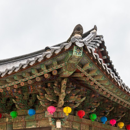 Detail view on roof of korean buddhist Bulguksa Temple with many lanterns to celebrate buddhas birthday on a clear day. Located in Gyeongju, South Korea, Asia.