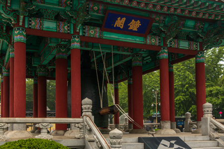View on traditional korean Bell Pavilion with cloche and equipment in the Yongdusan Park. Busan, South Korea, Asia. 写真素材