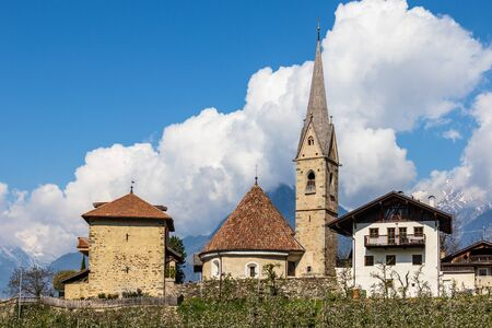 Panorama of Church, Sankt Georgen Kirche and Tower, Uhlenturm in Schenna. Scena, South Tyrol, Italy. Europe.