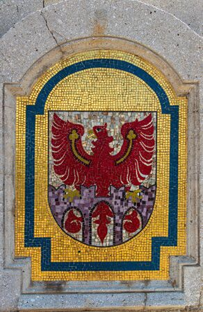 Stone Crest, Emblem, Flag of City Meran on a bridge in the central district. Merano. Province Bolzano, South Tyrol, Italy. Europe.