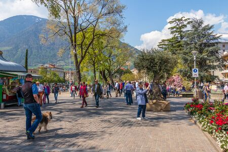 Street scenario view on Passer Promenade in City Meran with many pedestrians. Merano. Province Bolzano, South Tyrol, Italy. Europe. Stockfoto
