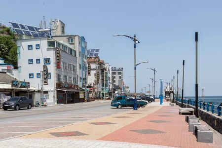 Street Scenario with Buildings and Promenade of Mukho Port, Donghae City, Gangwon Province, South Korea, Asia.