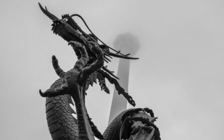 Busan Tower with korean Dragon Statue in front on a foggy day. Jung-gu, Busan, South Korea. Asia.