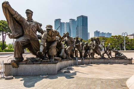 Monument with fighting Soldiers Company in War Memorial of Korea for peaceful reunification. Yongsan, Seoul, South Korea, Asia.