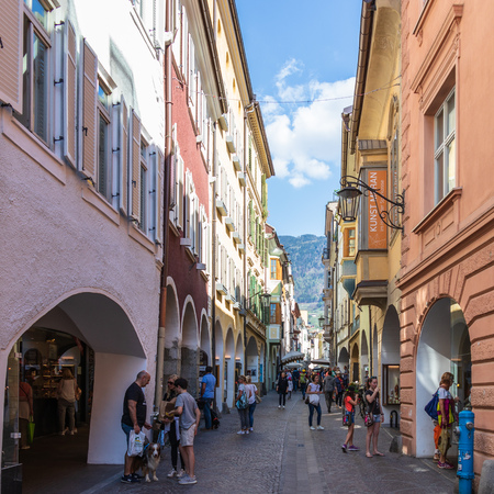 Street scenario of Laubengasse in the main District of Meran with many pedestrians. Merano. Province Bolzano, South Tyrol, Italy. Europe.