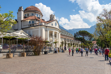 Street scenario of Passer Promenade with facade of famous building, Kurhaus in Meran. Province Bolzano, South Tyrol, Italy. Europe.