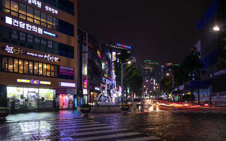 Street Scenario with Buildings, Central Square and traffic lights during Night of Busanjin District, Busan, South Korea. Asia.