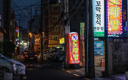 Street Scenario with Shops and traffic during Night of Nam District, Busan, South Korea. Asia.