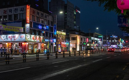 Street Scenario with Buildings and traffic during Night of Nam District, Busan, South Korea. Asia.
