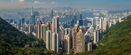 Wide Panorama of Victoria Harbour, Bay and Skyline. Taken from Victoria Peak Park on Hongkong Island. Hong Kong, China