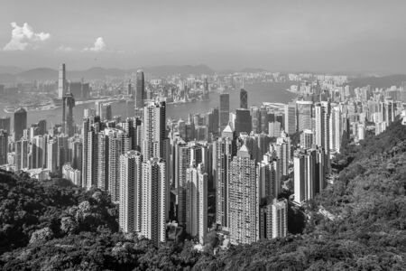 Panoramic view on Skyscrapers of Victoria Harbour and Hong Kong Bay. Taken from Victoria Peak Park on Hongkong Island. Hong Kong, China