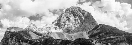 Shape of Western Wall of Mount Mangart with Hikers. Look from Mangart Saddle, Mangartsko sedlo. Border between Slovenia and Italy. Europe