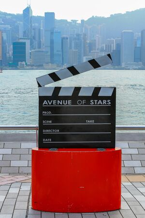 View on Monument of Avenue of Stars near the promenade. Skyline of Hongkong Island in background. Hong Kong, China. Stok Fotoğraf - 131957868