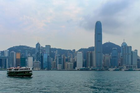 Skyline Panorama with Victoria Bay, Star Ferry and Hongkong Island in the background taken from Kowloon. Hong Kong, China, Asia