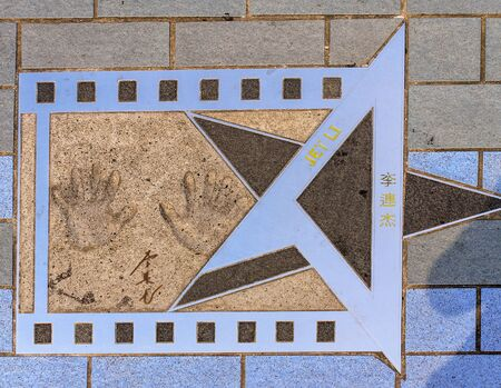 Jet Li Monument with handprints, signature and Name on the Avenue of Stars in Tsim Sha Tsui, Hong Kong, China.