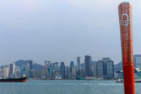 Monument of Olympic Games 2008. On Avenue of Stars near promenade. Skyline of Hongkong in background. Tsim Sha Tsui, Hong Kong, China. Stok Fotoğraf - 131960061