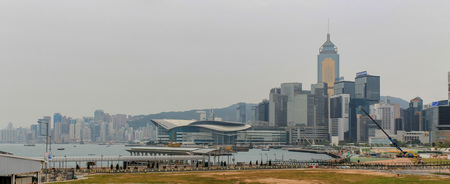 View on Skyline of Hongkong Island with Central Tower, surrounded Buildings and Harbour on a foggy day. Hong Kong, China, Asia