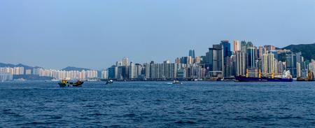Skyline Panorama with Victoria Bay, Boats and Hongkong Island in the background. Taken from Kowloon. Hong Kong, China, Asia Sajtókép