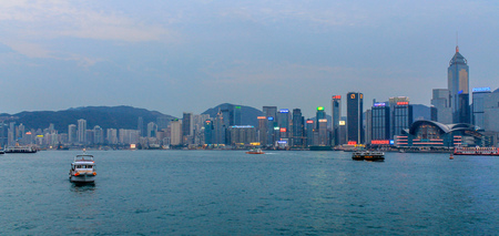 Large Skyline Panorama with Victoria Bay, Star Ferry and Hongkong Island in the background. Taken from Kowloon. Hong Kong, China, Asia