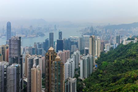 Hongkong Skyline with Victoria Bay, Harbour and Kownloon with smog from China. Hongkong Island Peak. Hong Kong, China