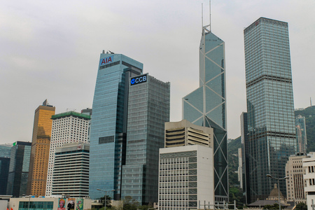 Panorama view on Bank of China Tower on a foggy day between surrounded Skyscrapers. High Buildings on Hong Kong Island, China. Asia