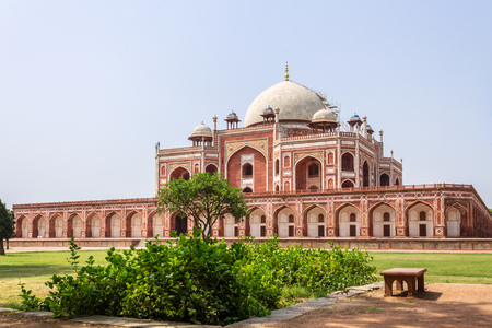 Side Panorama of Humayuns Tomb Complex with square, park and vegetation. UNESCO World Heritage in Delhi, India. Asia.