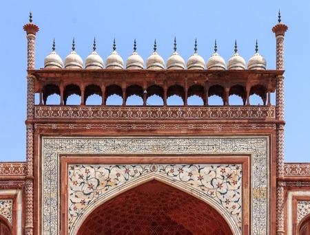Mosaic and fresco of the Great Gate of Taj Mahal Complex. Entrance to the Taj. UNESCO World Heritage in Agra, Uttar Pradesh, India