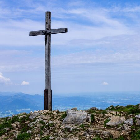 Panorama with Summit Cross on Hochries, 1596 m in Chiemgauer Alps, Ostalpen, located in Samerberg, Upper Bavaria, Germany