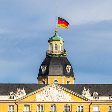 German Flag at Halfmast, auf Halbmast, on the top of Castle Karlsruhe. In Karlsruhe, Baden-Württemberg, Germany Éditoriale