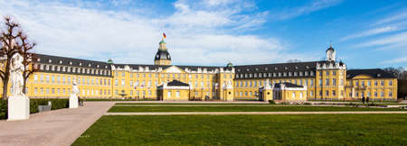 Side Panorama of Main Entrance of Castle Karlsruhe with Garden and Buildings. In Karlsruhe, Baden-Württemberg, Germany