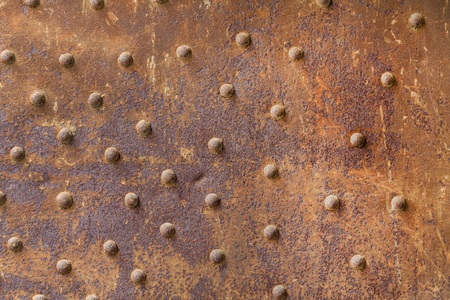 Rusty metal from metal rivets, beautiful metal texture, metallic background