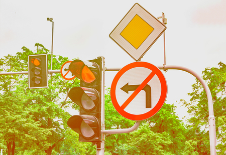 Road signs, the traffic light is red, the turn to the left is forbidden