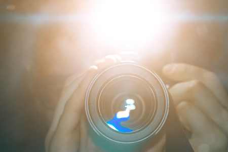 Bright flash of the camera, reflection of the camera in the mirror