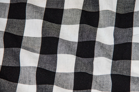 Texture of a crumpled shirt, white black cloth for a background