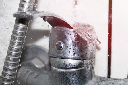 A wet faucet in the shower, water flows from the shower 스톡 콘텐츠