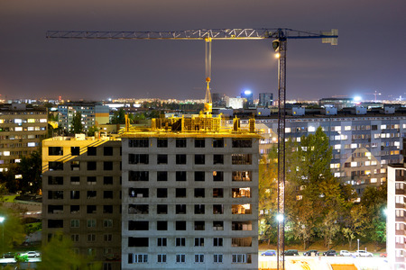 Night city Wroclaw, High-rise buildings, tower crane