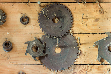 Circular saws. Circular saws for woodworking on wooden background