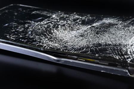Broken phone on black background, phone repair advertisement