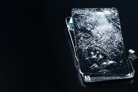 closeup broken phone on black background repairing phones 免版税图像