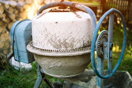 cement mixer in construction area. Old cement mixer