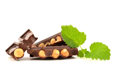 Chocolate with hazelnuts, isolated on white.