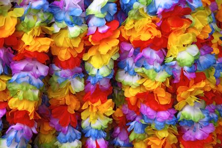 Several hawaiian garlands hanging one after another